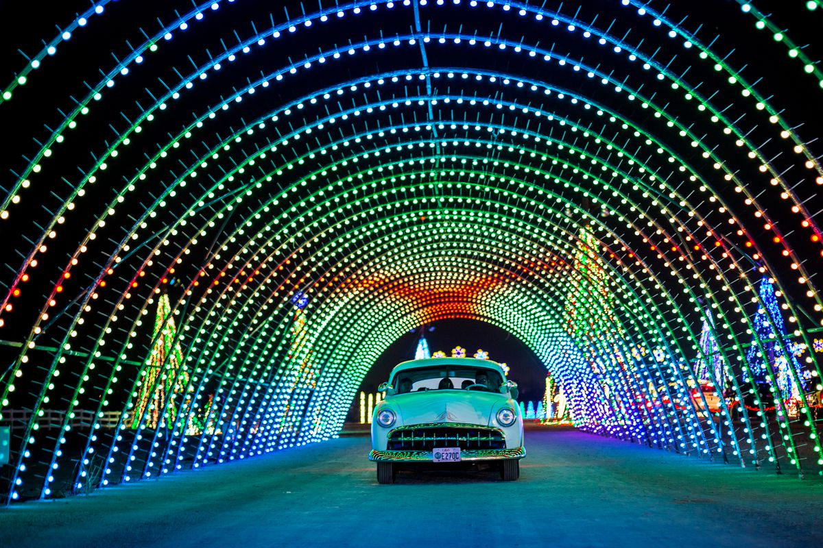 A car drives through the Christmas in Color drive-thru lighting show in South Jordan.