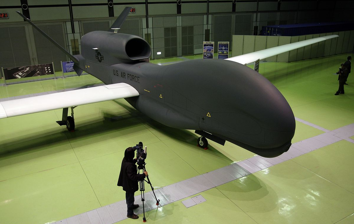 A full-scale model of the RQ-4 Global Hawk unmanned drone is displayed during a presentation at PiO Exhibition Center on March 24, 2010 in Tokyo, Japan.