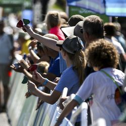 Fans cheer for riders at the finish line for Stage 3 of the Tour of Utah at Eaglewood Golf Course in North Salt Lake on Thursday, Aug. 15, 2019.
