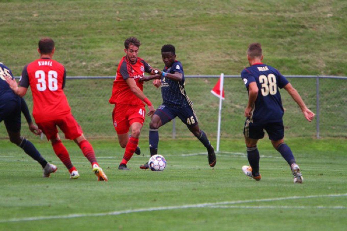 USL Photo - Toronto FC II's Robert Boskovic attempts to keep Bethlehem Steel FC's Michee Ngalina at bay in Saturday's 4-0 loss at Goodman Stadium
