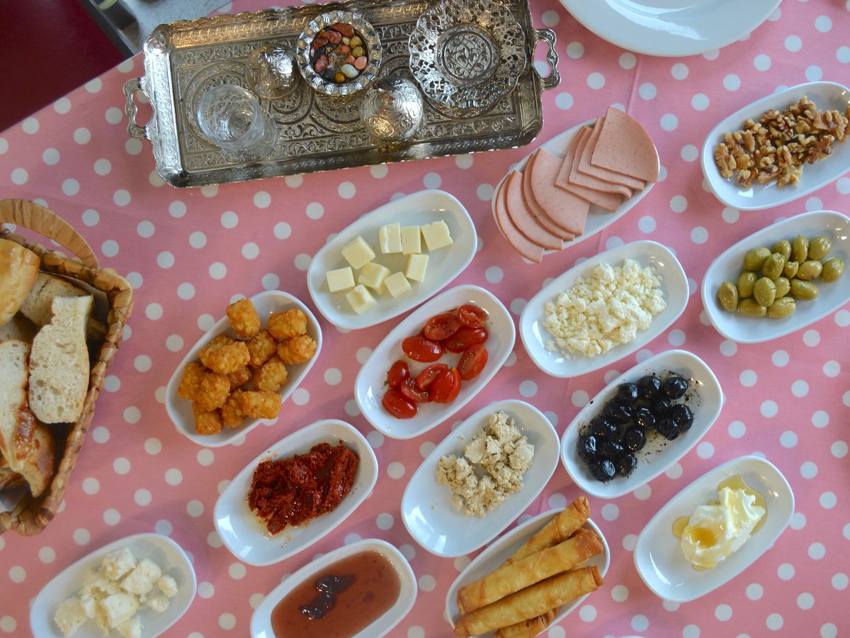 Turkish breakfast of meats, cheeses, olives, nuts, halvah, and more