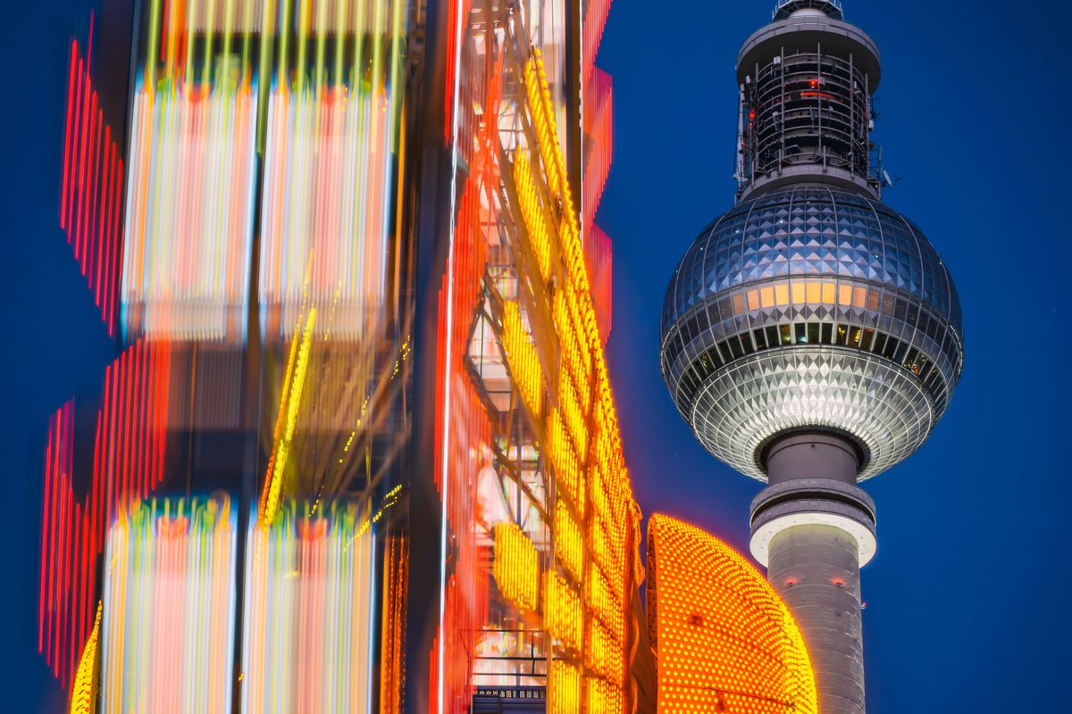 A colorful set of billboards and a tower in Berlin, Germany.