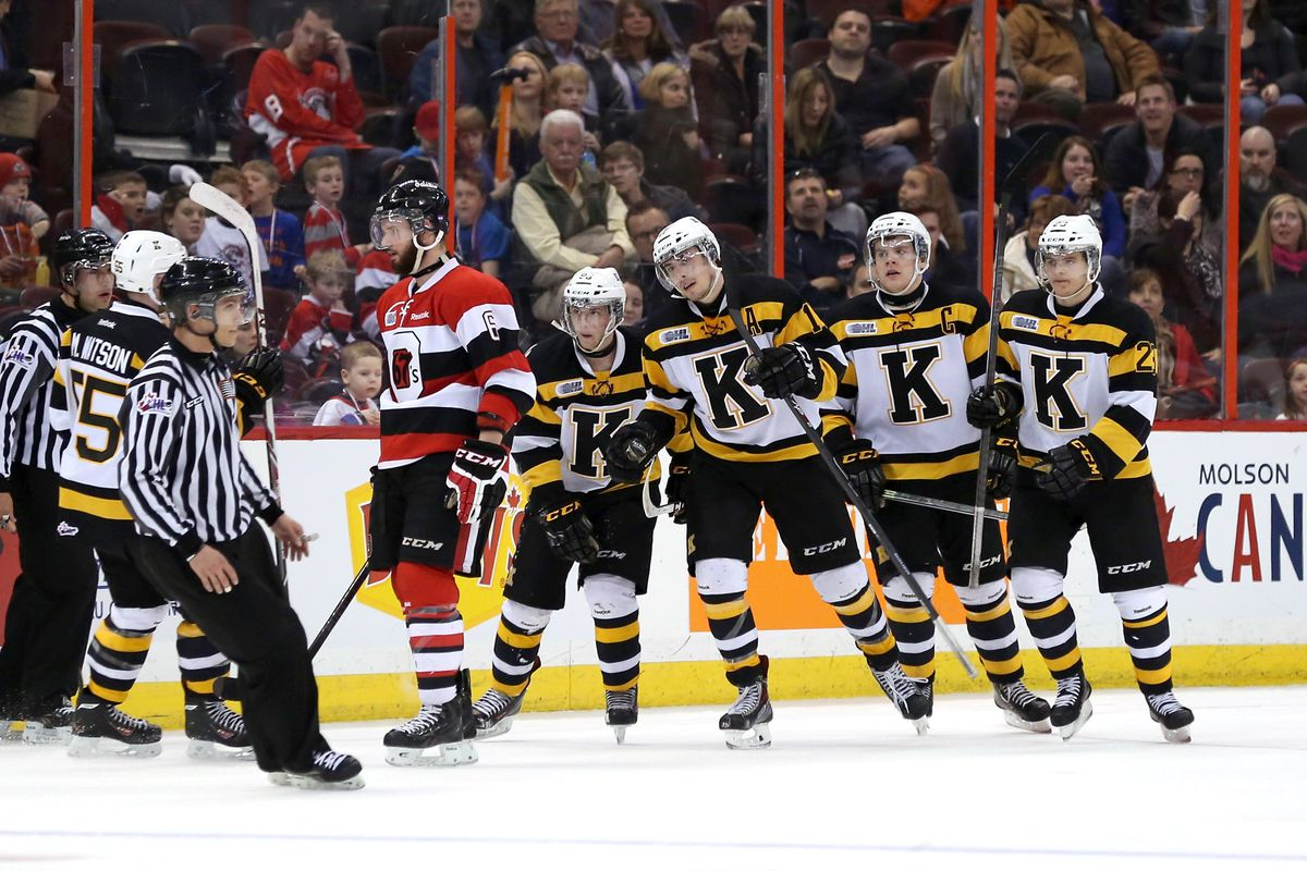 New Jersey Devils prospect Ryan Kujawinski #17 of the Kingston Frontenacs celebrates his third period goal against the Ottawa 67's with teammates.