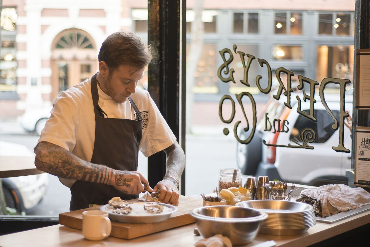 Derek May shucking oysters at Percy's and Co.