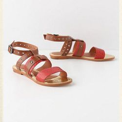 """<a href=""""http://www.anthropologie.com/anthro/product/shopsale-shoes/23983026.jsp"""">Ulli sandals</a>, $79.95 (were $168)"""
