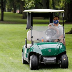 Mount Carmel golf coach Anthony Massino looks on from his golf cart during practice at Jackson Park Golf Course.