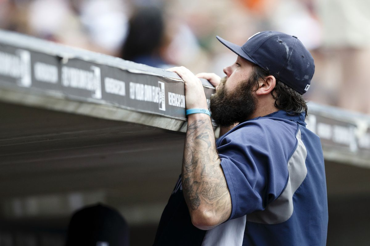 Joba Chamberlain looks over the top of the dugout before the July 9 game against the Dodgers at Comerica Park