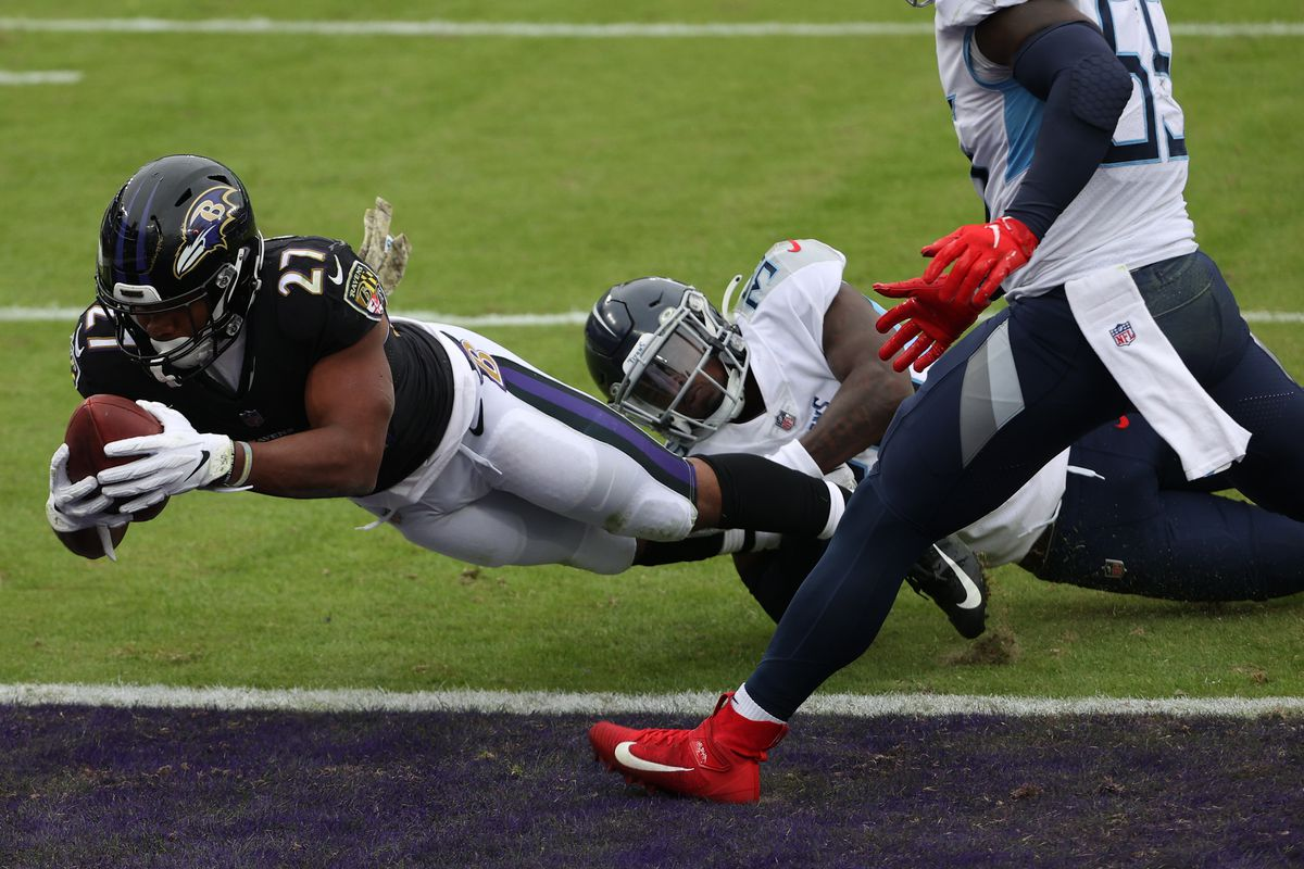 Running back J.K. Dobbins #27 of the Baltimore Ravens scores a two point conversion against the Tennessee Titans during the first half at M&T Bank Stadium on November 22, 2020 in Baltimore, Maryland.