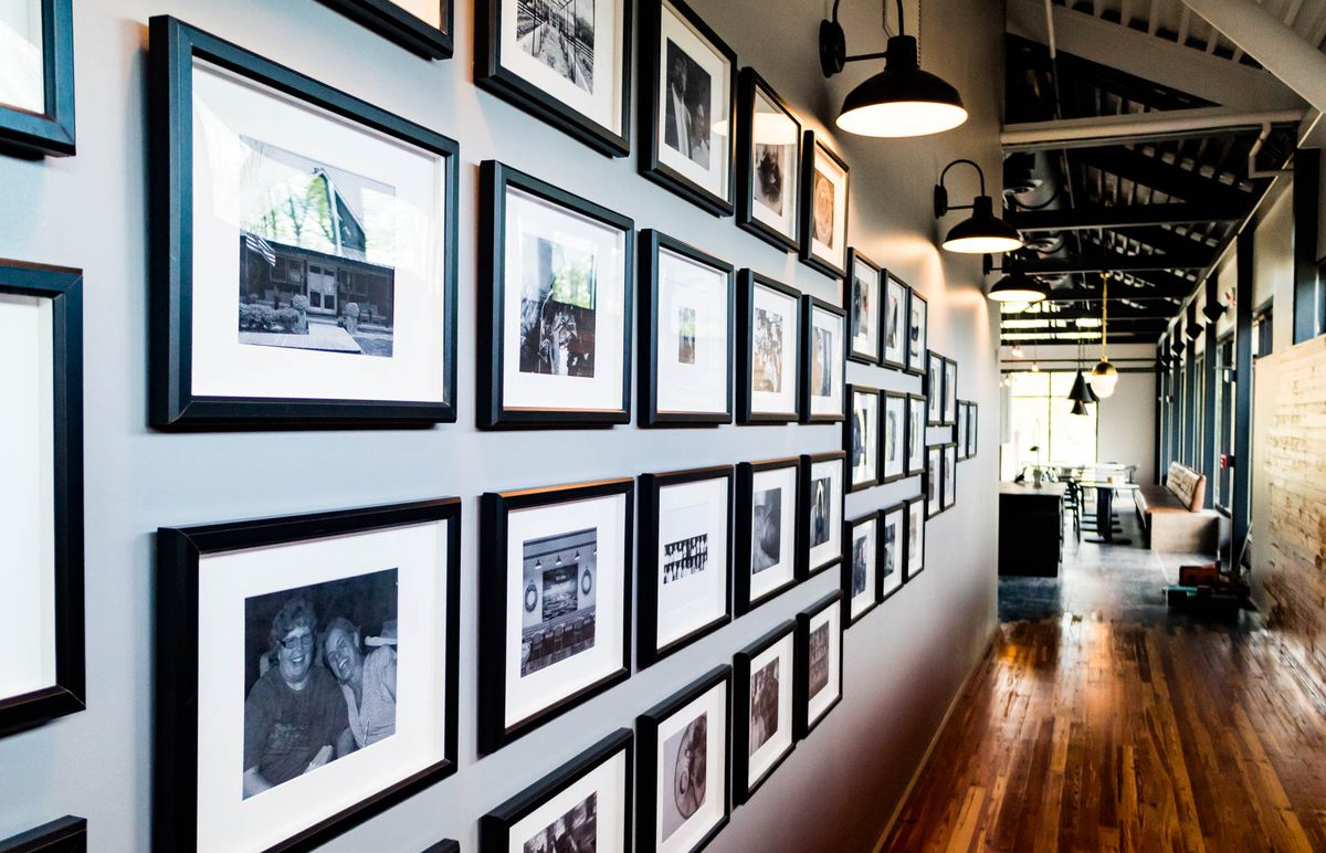 The hallway between Bacchanalia is lined with photos: memories from Quatrano and Harrison's restaurants.