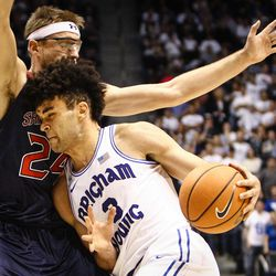 Brigham Young Cougars guard Elijah Bryant (3) attempts to drive through the defense of Saint Mary's Calvin Hermanson (24) as the BYU Cougars take on the Saint Mary's Gaels in the Marriott Center in Provo on Saturday, Dec. 30, 2017.