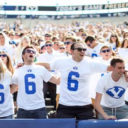 Brigham Young Cougars fans cheer before the game against the Wisconsin Badgers at LaVell Edwards Stadium in Provo on Saturday, Sept. 16, 2017.