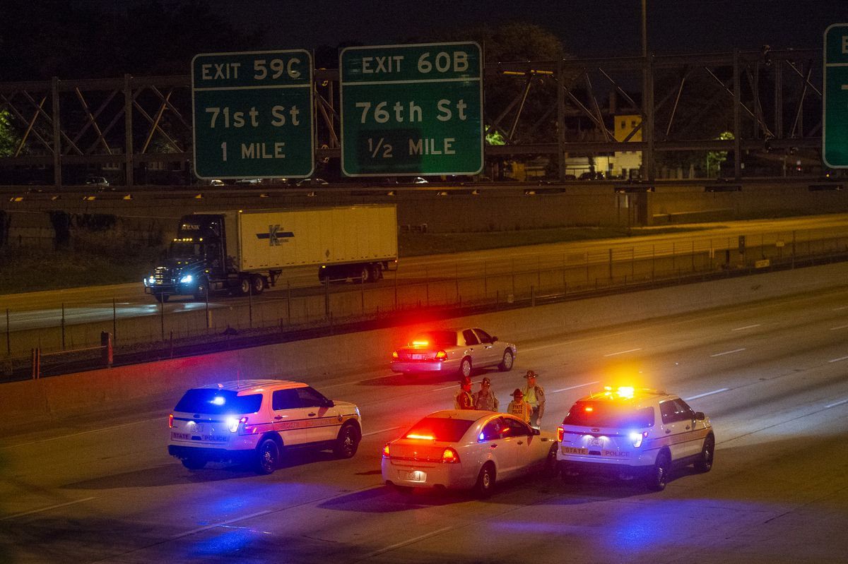State police investigate the scene of a shooting Sunday night on the northbound lane of the Dan Ryan Expressway near 79th Street. | Tyler LaRiviere/Sun-Times