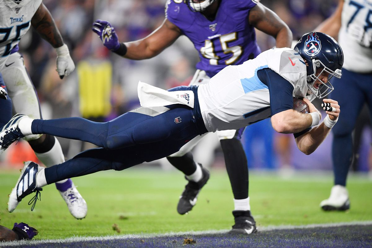 Tennessee Titans quarterback Ryan Tannehill dives into the end zone for a touchdown against the Baltimore Ravens in the third quarter in a AFC Divisional Round playoff football game at M&T Bank Stadium.