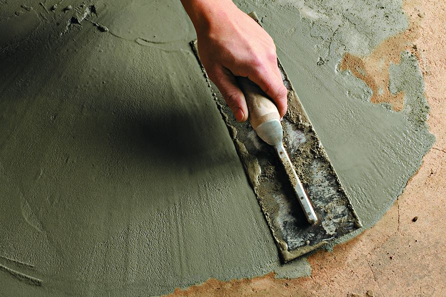 <p>4. To burnish the surface very smooth, use a steel trowel (shown) on the final few passes</p>