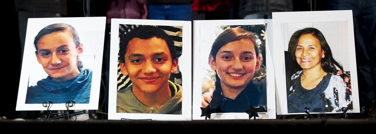 Photographs of Consuelo Alejandra Haynie, 52, right, and three of her children, 12-year-old Milan Haynie, 14-year-old Matthew Haynie, and 15-year-old Alexis Haynie, left to right, are displayed at a candlelight vigil for the Haynie family at City Park in Grantsville on Monday, Jan. 20, 2020.