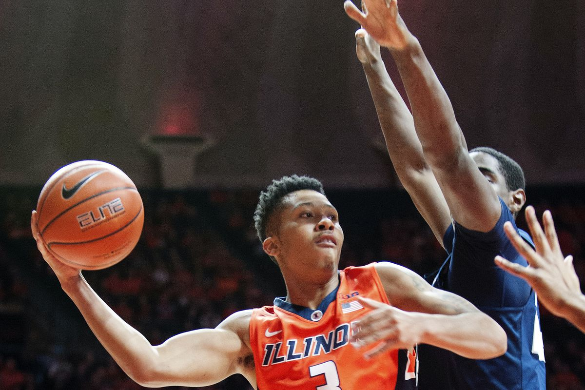 Illinois' guard Te'Jon Lucas (3) looks to pass under the basket as Penn State's forward Mike Watkins defends.