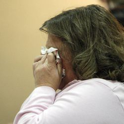"""Christina Burak wipes away tears as family and friends of Matthew David Stewart gather during a """"Keep the Peace"""" rally in Ogden Thursday, April 12, 2012. Stewart, a decorated former U.S. Army soldier, is charged with capital murder in the shooting death of Ogden police officer Jared Francom."""