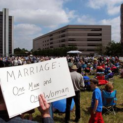 Hundreds of people gather behind the state capitol for a rally supporting a constitutional ban on gay marriage in Raleigh, N.C., on Friday, April 20, 2012. Voters will decide May 8 whether North Carolina will remain the only state in the South without such a constitutional ban.