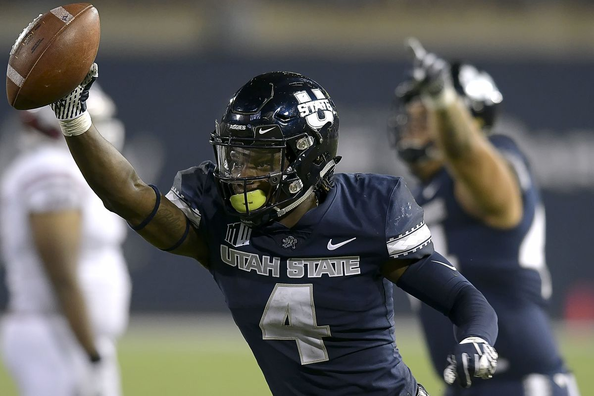 Utah State safety Aaron Wade celebrates after intercepting a New Mexico State pass Saturday, Sept. 8, 2018, in Logan, Utah. The Aggies will head south on Friday for a matchup with the Cougars at LaVell Edwards Stadium.