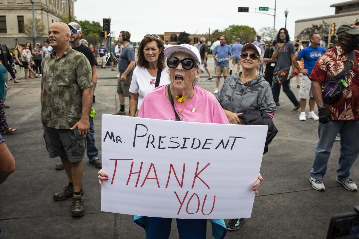 Supporters of President Donald Trump and Black Lives Matter protesters argue and shout over each other outside of the Kenosha County Courthouse, in anticipation of the president's arrive in the Wisconsin city, Tuesday afternoon