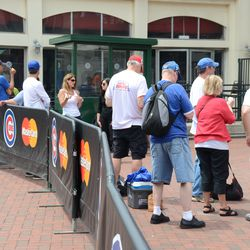 1:03 p.m. Charity event guests waiting outside Gate D -