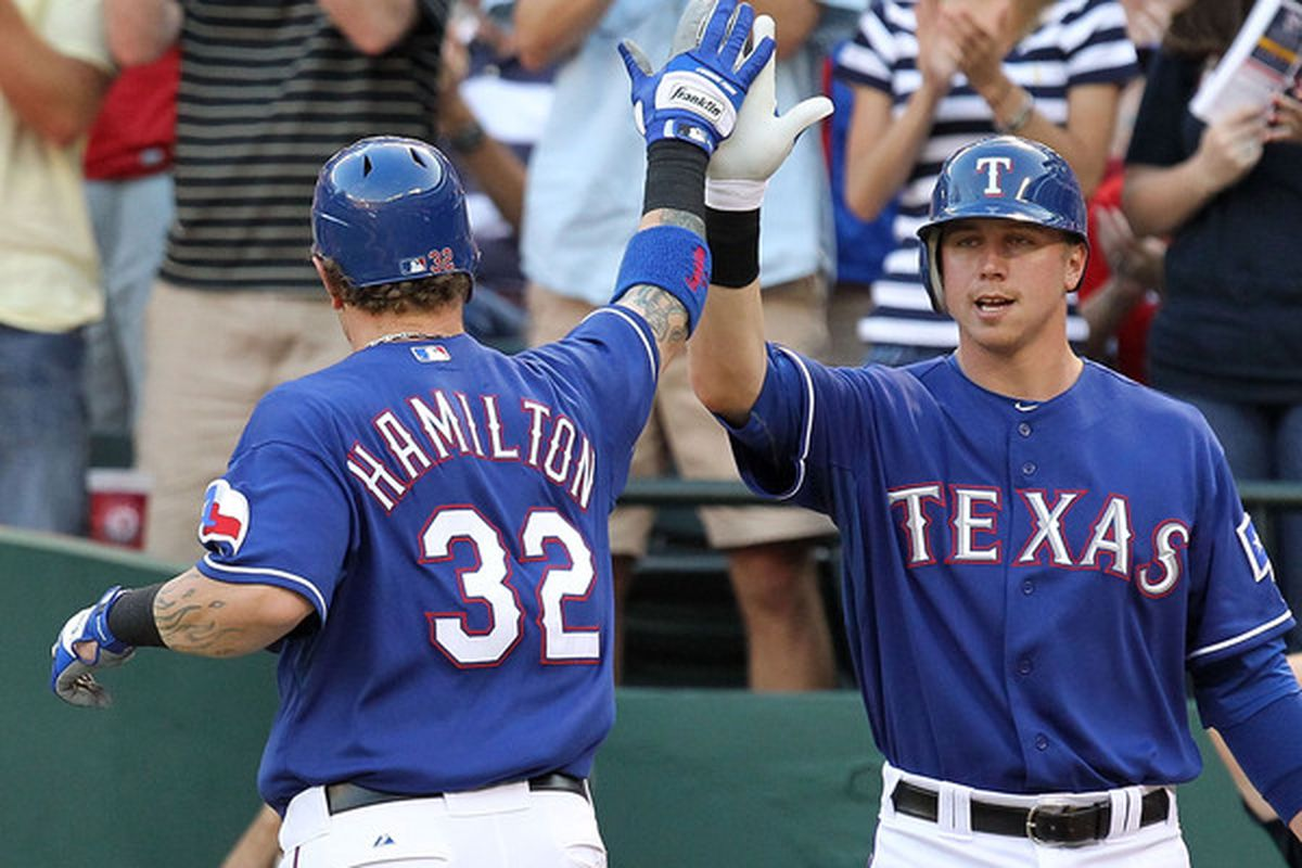 ARLINGTON, TX - MAY 19:  Josh Hamilton #32 of the Texas Rangers celebrates a homerun with Justin Smoak #12 against the Baltimore Orioles on May 19, 2010 at Rangers Ballpark in Arlington, Texas.  (Photo by Ronald Martinez/Getty Images)
