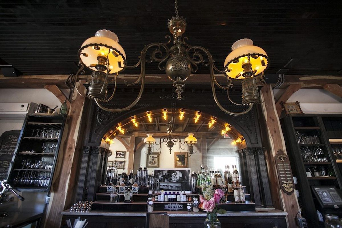 Freedmen's features an authentic antique bar from Brownsville, TX.