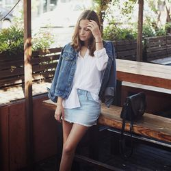 """Bethany of <a href=""""http://www.bethanystruble.com """"target=""""_blank"""">Snakes Nest</a> is wearing a vintage top, a vintage Levi's jacket, a Hudson skirt, a vintage Coach bag and a <a href=""""http://www.dogeared.com/balance-spiky-spear-necklace%2C-gold-dipped/V"""