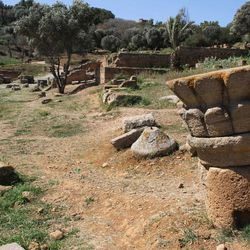 In this March 10, 2012 photo, a carved fragment of a pillar rests on the grassy forum of the old Roman city of Sala Colonia near the Moroccan capital Rabat.
