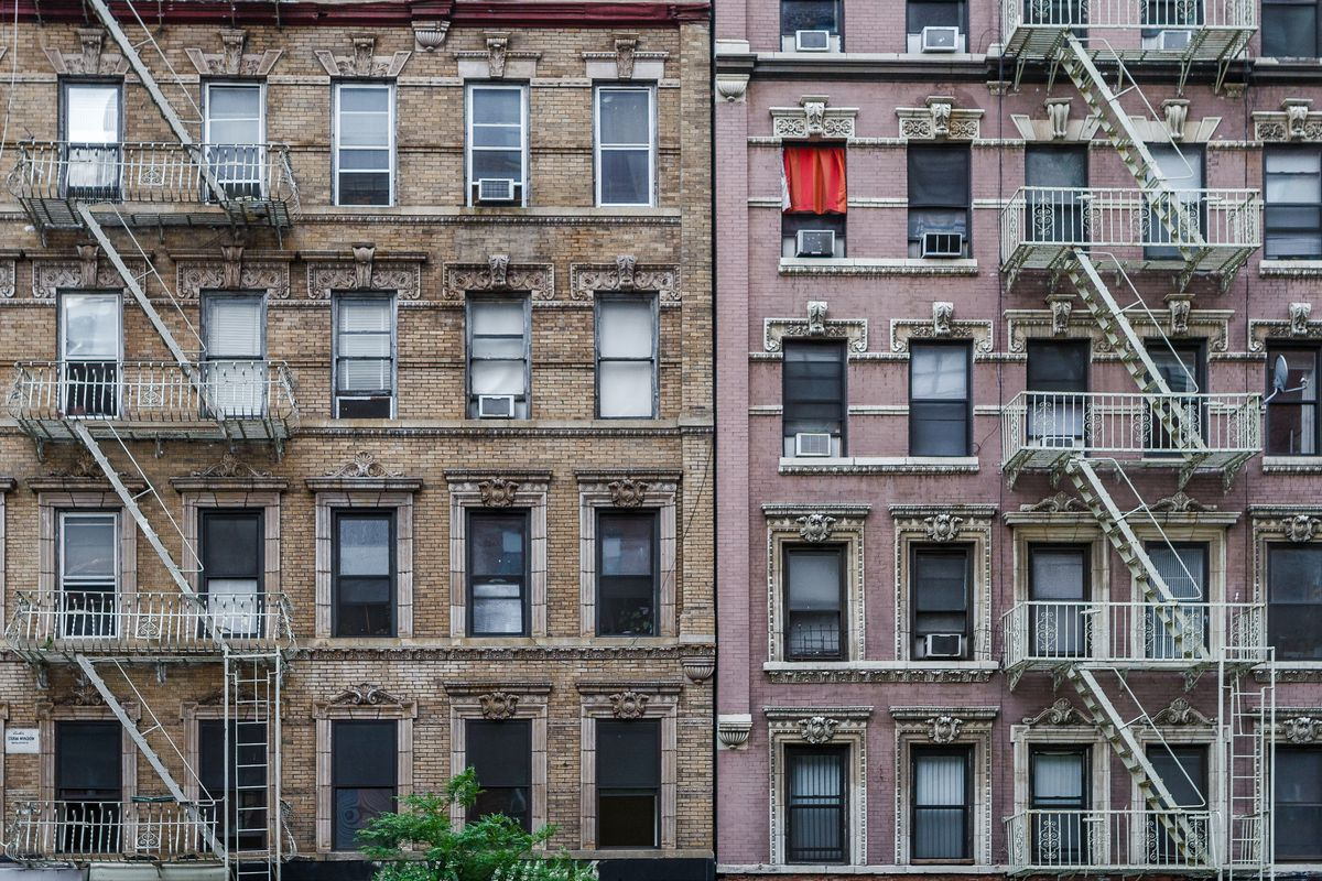Fire escapes and windows of a multi-storey building in Manhattan, New York City.