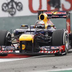 Red Bull Formula One driver Sebastian Vettel of Germany steers his car during the Chinese Formula One Grand Prix in Shanghai, China, Sunday, April 15, 2012. (AP Photo/Mark Baker)