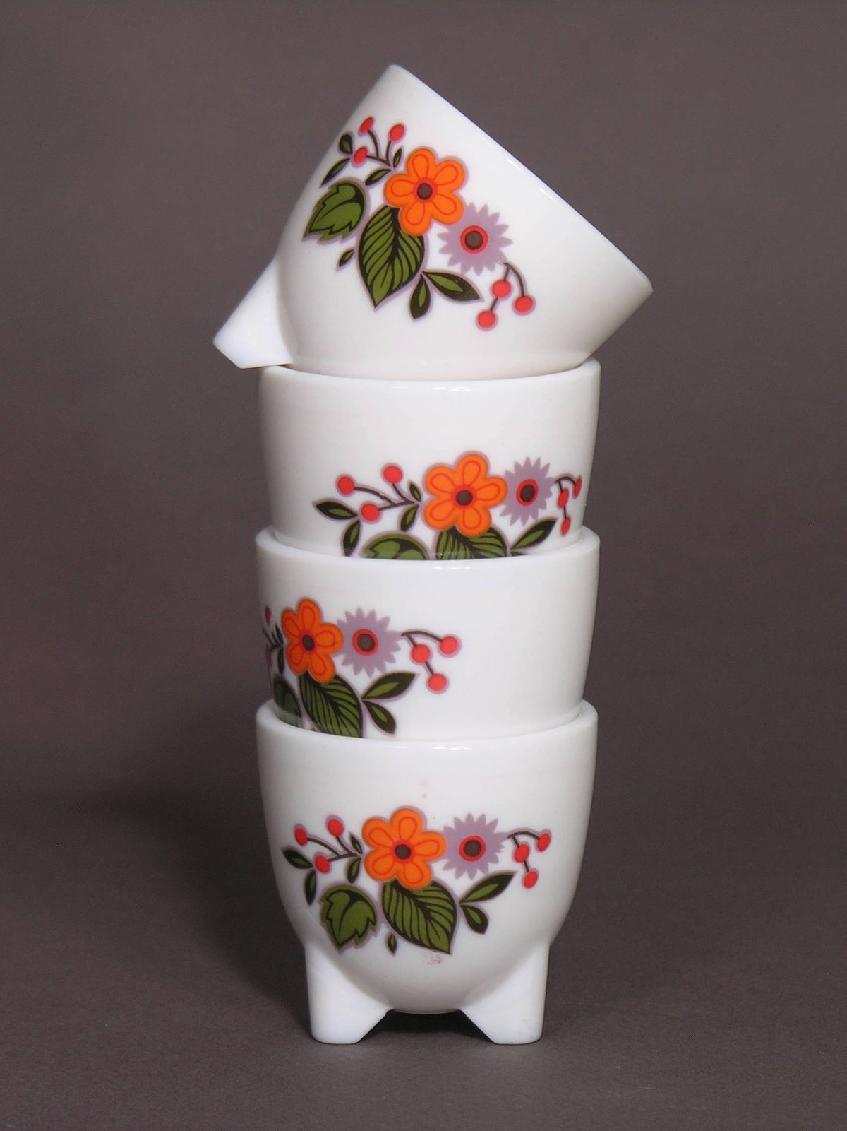 Four painted egg cups