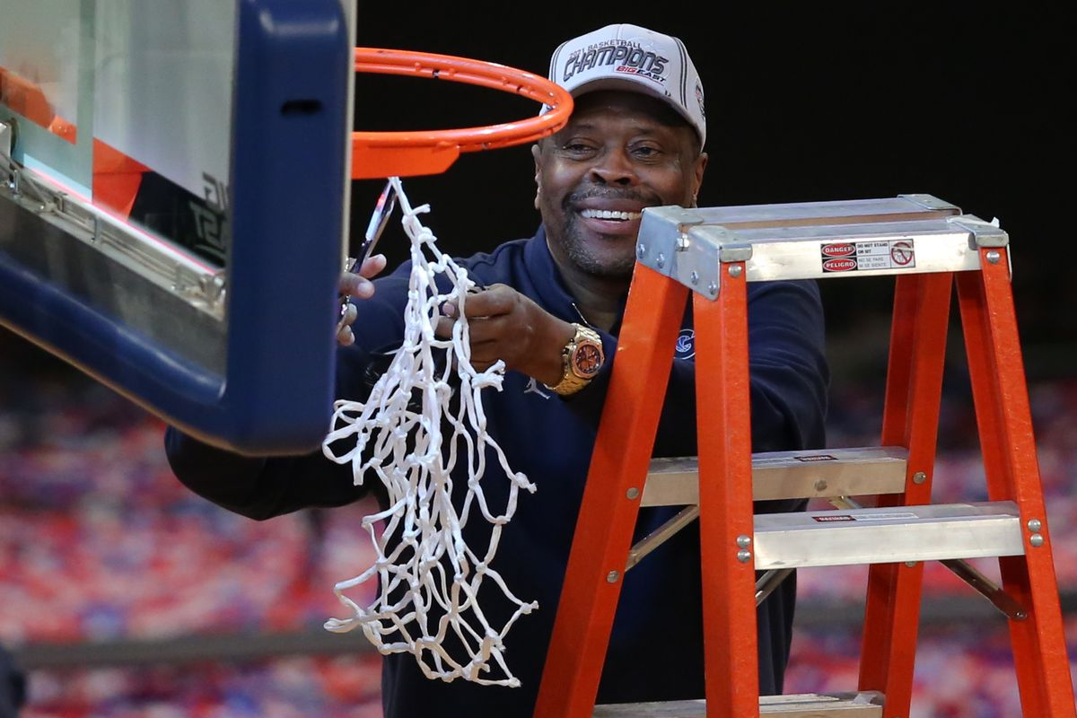 Georgetown Hoyas head coach Patrick Ewing cuts down the net after defeating the Creighton Bluejays in the final game of the Big East tournament at Madison Square Garden.