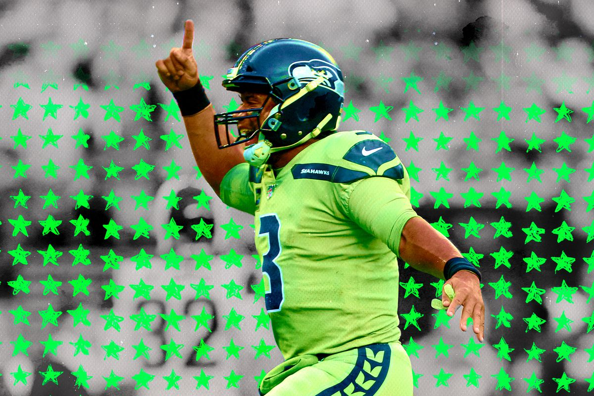 Seahawks QB Russell Wilson holds finger in the air in celebration, with illustrated green stars in the background
