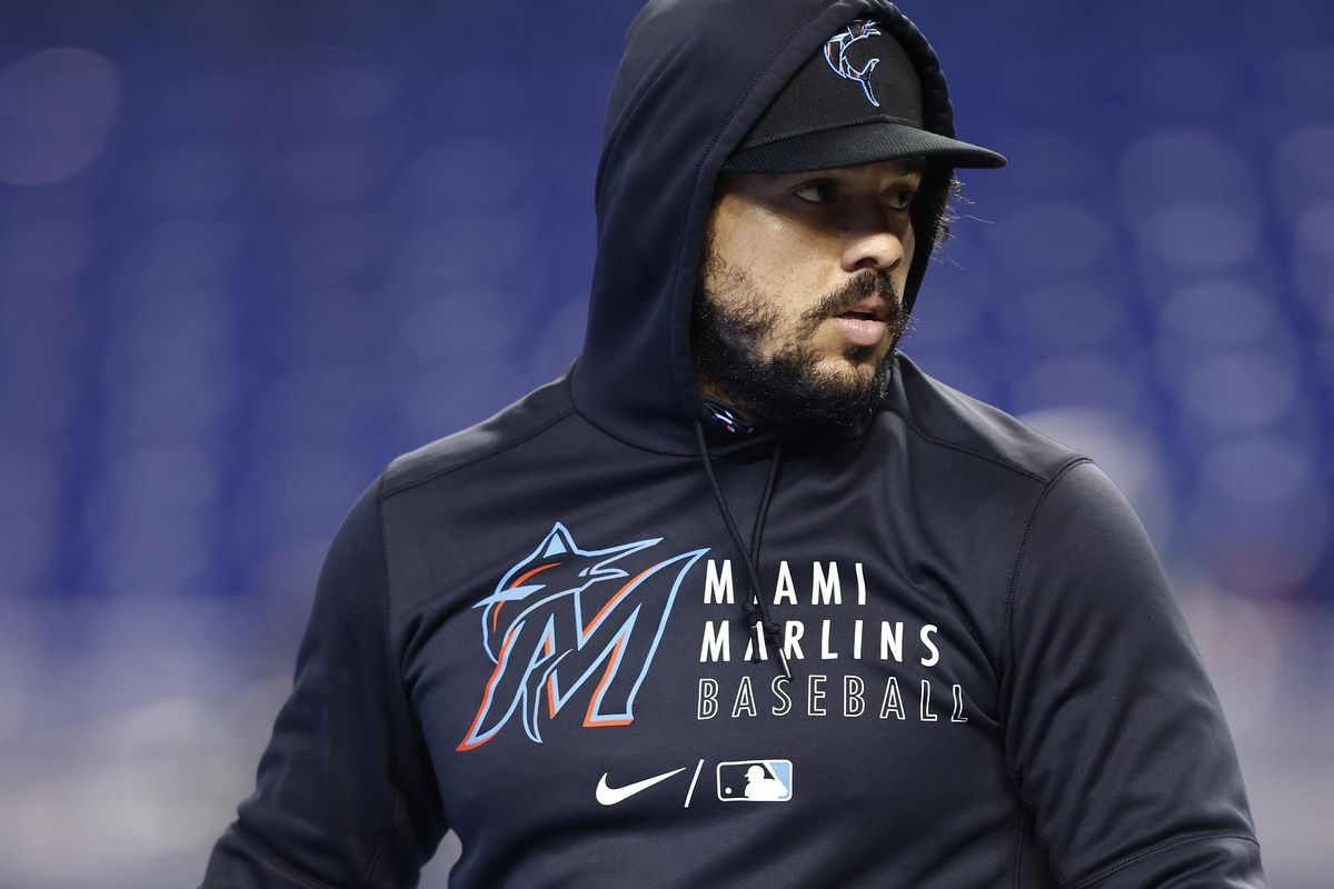 Jorge Alfaro #38 of the Miami Marlins looks on against the Colorado Rockies during batting practice at loanDepot park