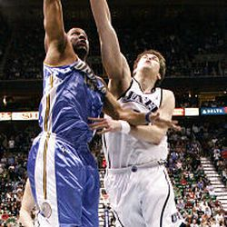 Kyrylo Fesenko #44 of the Utah Jazz defends Joey Graham #14 of the Denver Nuggets as the Jazz-Nuggets play in game 3 of the Western Conference Playoffs in Energy Solutions Arena.