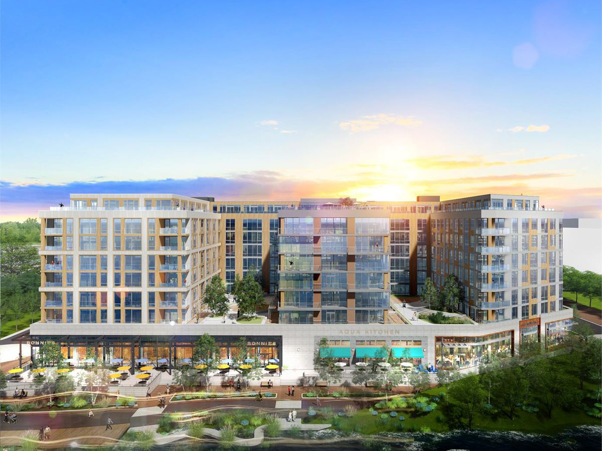 A rendering of a planned waterfront development project with ground-floor retail and residential towers.
