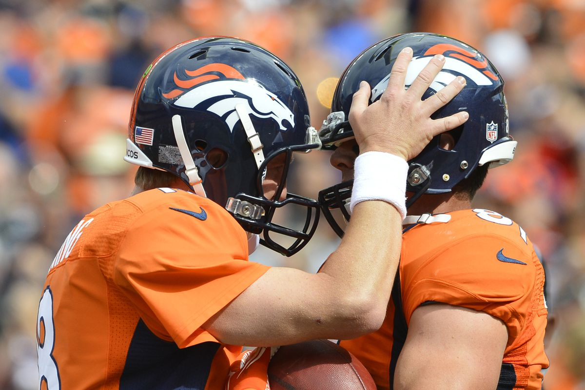 Denver Broncos quarterback Peyton Manning and tight end Joel Dreessen celebrate after a touchdown in 2012.