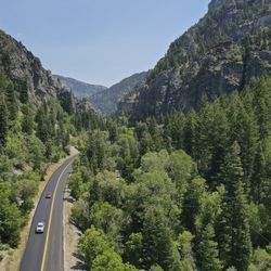 Motorists drive near Timpanogos Cave in American Fork Canyon on Tuesday, July 21, 2020. Visits to all national parks in Utah this summer are drastically down with the exception of Timpanogos Cave.