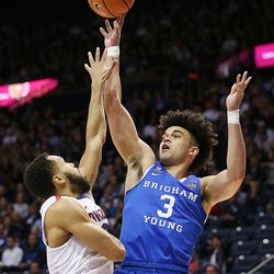 Brigham Young Cougars guard Elijah Bryant (3) pushes up a shot over Gonzaga Bulldogs guard Silas Melson (0) as BYU and Gonzaga play in an NCAA basketball game in the Marriott Center in Provo on Saturday, Feb. 24, 2018.