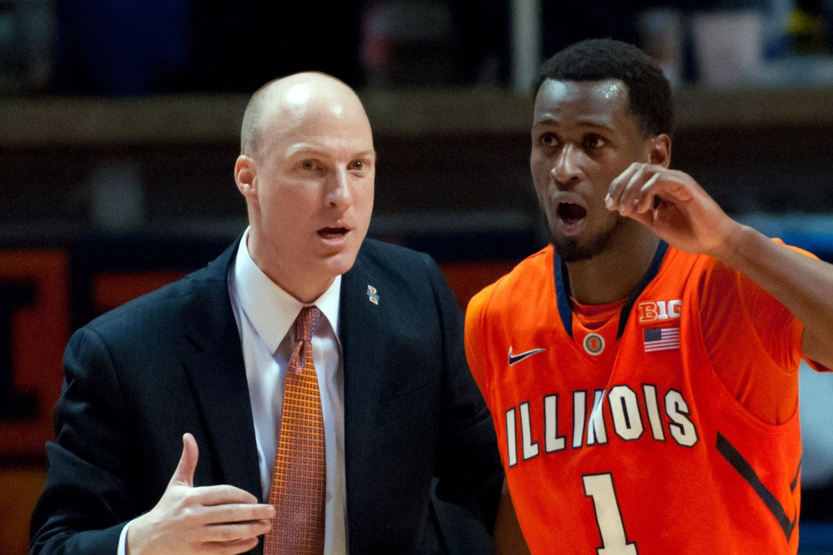 John Groce explains to D.J. how voting works