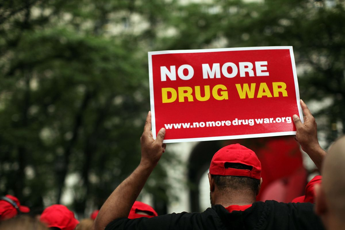 end the war on drugs protester