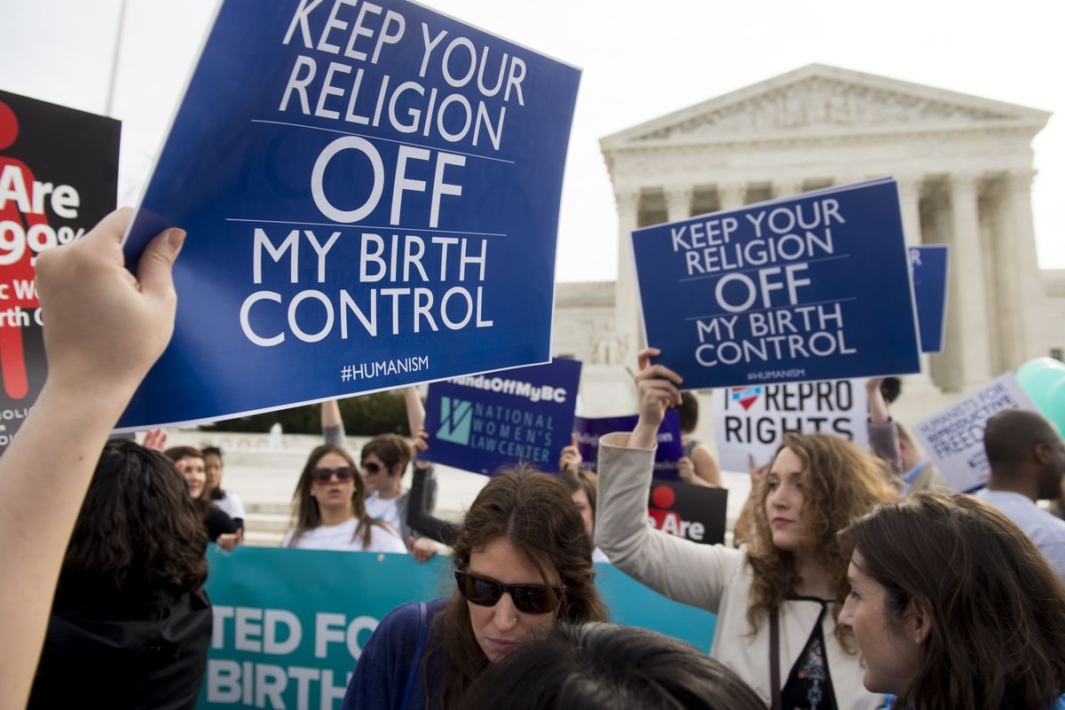 Supporters of birth control coverage rally outside the Supreme Court in Washington, DC, on March 23, 2016