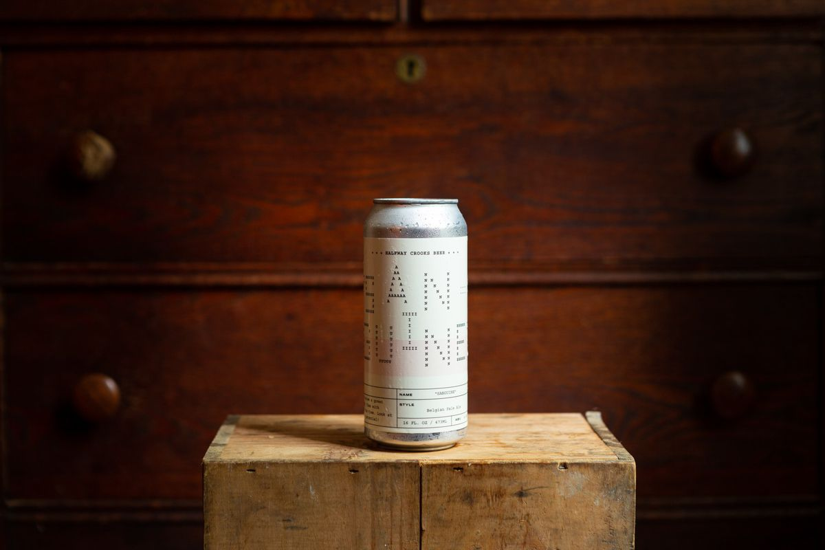 A can of Sanguine Belgian-style pale ale with analog labeling from Halfway Crooks Beer in summerhill Atlanta