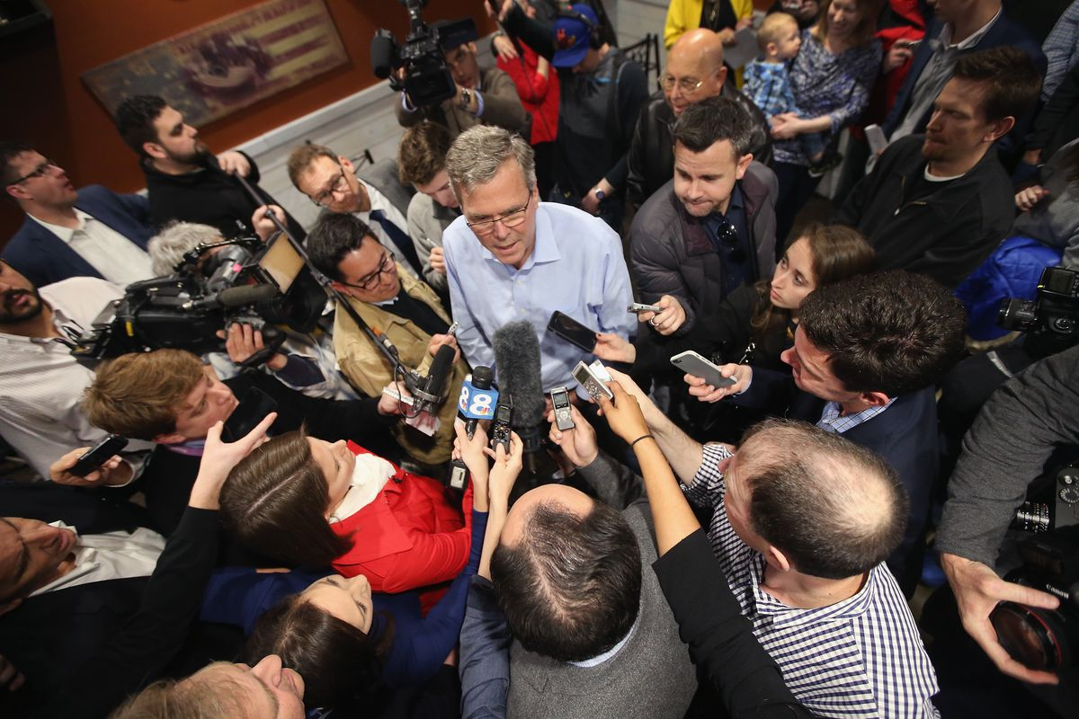 Jeb Bush answering questions after an Iowa event on Friday.