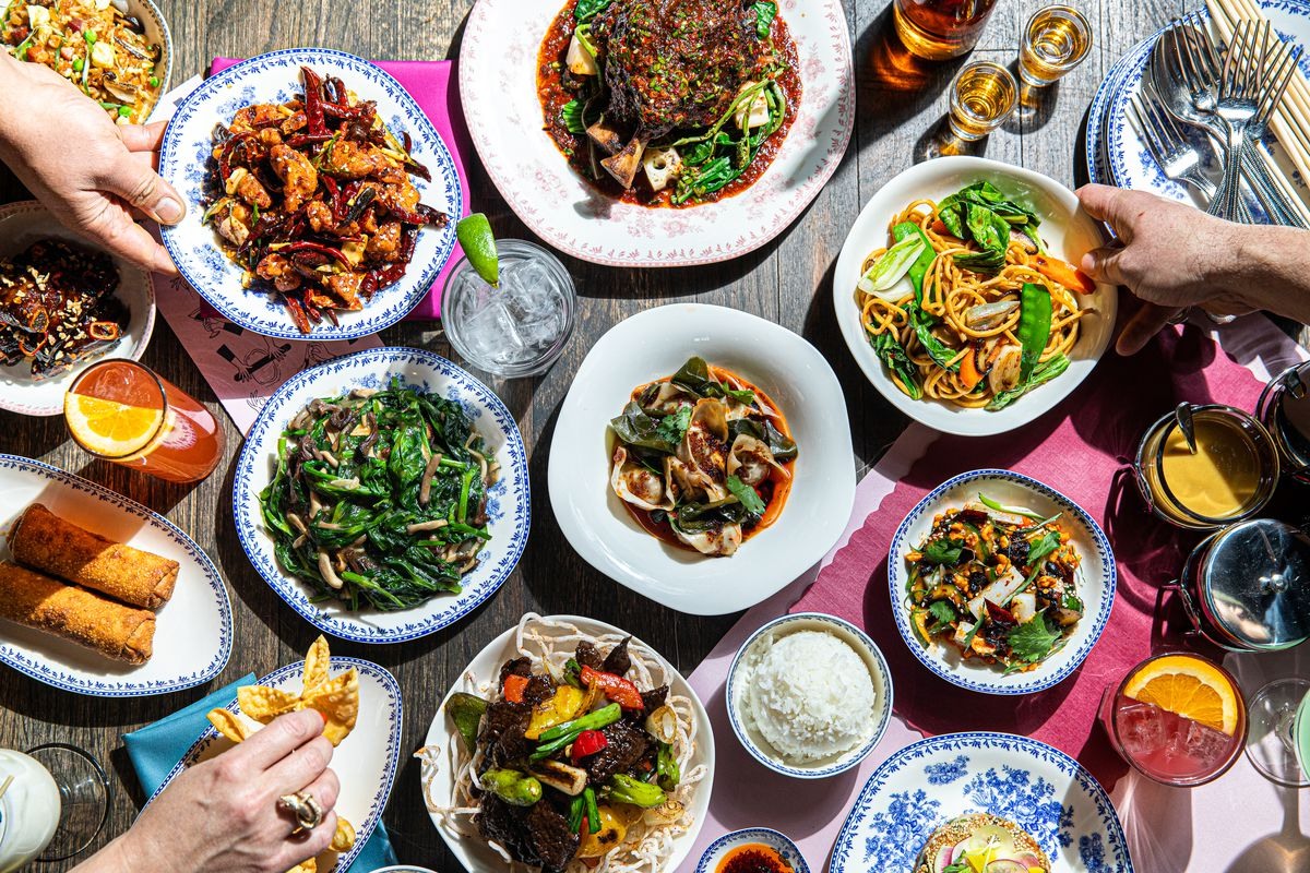 Several plates of Chinese-American food on a table.
