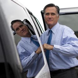 FILE - In this Aug. 18, 2012 file photo, Republican presidential candidate, former Massachusetts Gov. Mitt Romney gets into his car to attend a fundraising event on Saturday, Aug. 18, 2012 in Nantucket, Mass.