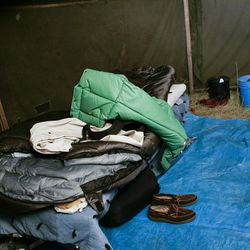 Tyson Lloyd's sleeping gear rests on his bed in the tent he and his tent mate Eric Richardson live in.