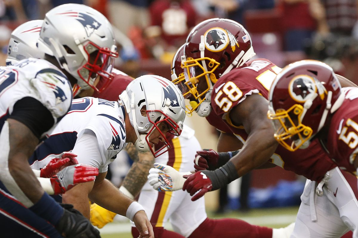 The New England Patriots offense prepares to block the Washington Redskins defense in the fourth quarter at FedExField.