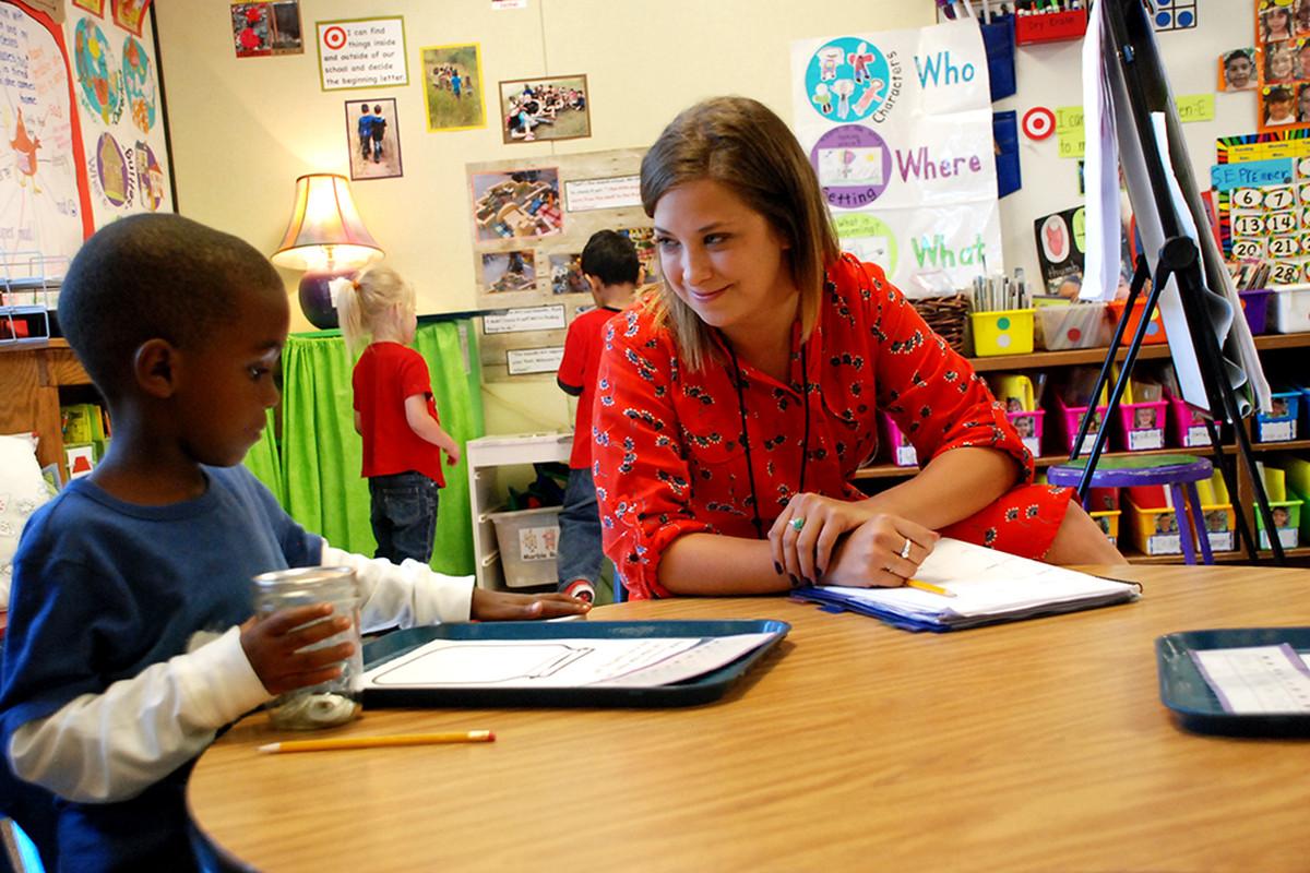 Stanley Teacher Prep resident Lily Wool works with kindergartner Samori McIntosh at Tollgate Elementary School in Aurora. Wood's residency program is merging the Boettcher Teacher Residency program.